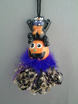 Black Cat a'top Pumpkin Tassel | www.classictasselsandmore.com